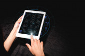 cropped view of astrologer holding digital tablet with zodiac signs on black velvet cloth