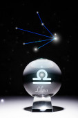 crystal ball with Libra zodiac sign isolated on black with constellation