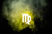 yellow illuminated Virgo zodiac sign with smoke on background