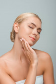 beautiful woman touching clean face isolated on grey