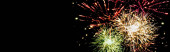 panoramic shot of colorful festive fireworks in night sky, isolated on black