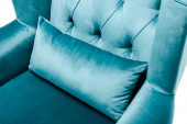 close up view of elegant velour blue armchair with pillow isolated on white