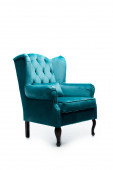 elegant velour blue armchair with pillow isolated on white