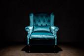 elegant velour blue armchair isolated on black