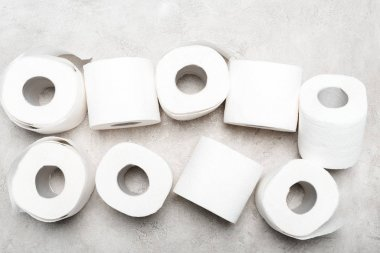 Top view of rolls of toilet paper on grey textured surface stock vector