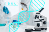 Photo selective focus of microscope and magnifying glass with dna illustration