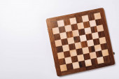 Top view of checkerboard on white background with copy space