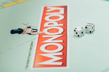 KYIV, UKRAINE - NOVEMBER 15, 2019: Selective focus of two dices on monopoly board game stock vector