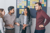 Photo cheerful multicultural coworkers smiling in office