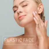 smiling woman touching face with facelift marks isolated on grey with plastic face illustration