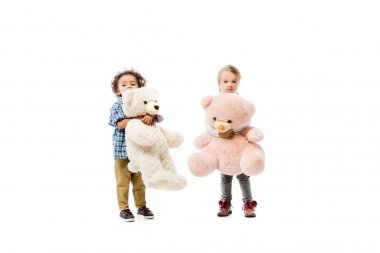 Multicultural kids holding teddy bears,  isolated on white stock vector
