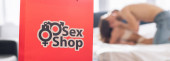 Photo panoramic shot of shopping bag with sex shop lettering