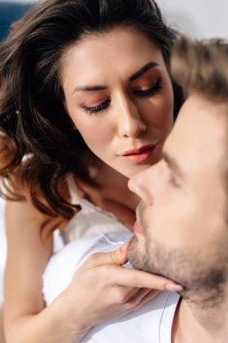 Selective focus of attractive girlfriend touching head of boyfriend stock vector