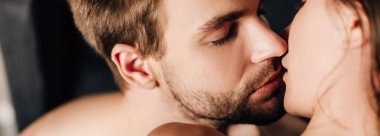 Panoramic shot of handsome boyfriend with closed eyes kissing girlfriend stock vector