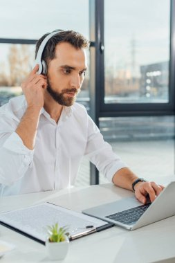 professional translator working online with headphones and laptop