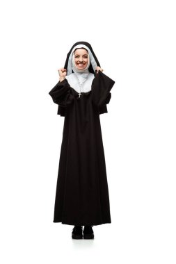 Beautiful young excited nun standing isolated on white stock vector