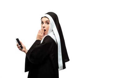 Beautiful surprised nun using smartphone isolated on white stock vector