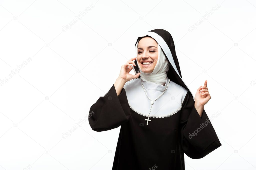 Beautiful happy nun talking on smartphone isolated on white stock vector
