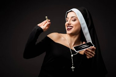 Happy nun holding dollar banknote and smartphone with cocaine lines isolated on grey stock vector