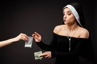 Thoughtful nun with money buying plastic bag of cocaine isolated on grey stock vector