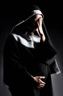 Sad crying pregnant nun touching tummy on grey stock vector