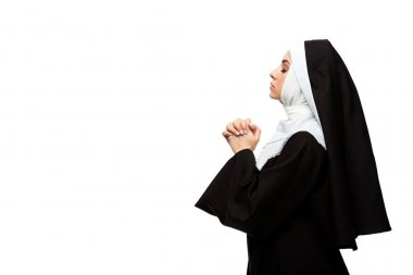 Attractive nun praying with closed eyes and hands together isolated on white stock vector