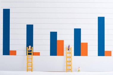 People figures with ladders on white surface with charts at background, equality concept stock vector