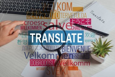 cropped view of translator working with hieroglyphics, laptop and magnifying glass, welcome translation illustration