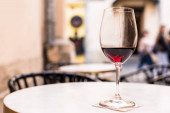 Selective focus of glass of red wine on table