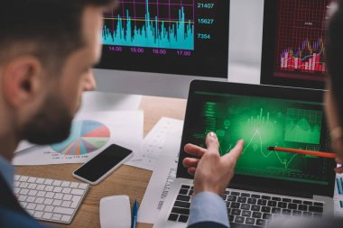 Selective focus of data analysts identifying problems while working with charts on computer monitors stock vector