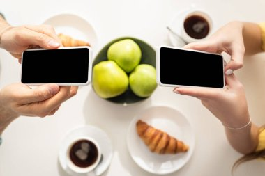 Top view of couple using smartphones near breakfast on table stock vector