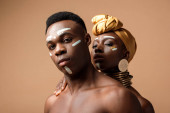 sexy naked tribal afro couple posing on beige