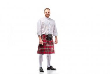 Smiling Scottish redhead bearded man in red tartan kilt on white background stock vector