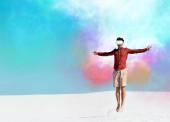 Mann am Sandstrand in vr Headset springen gegen klaren blauen Himmel, bunte Wolken Illustration