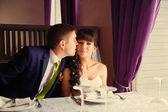 Lovely bride and groom in a beautiful room