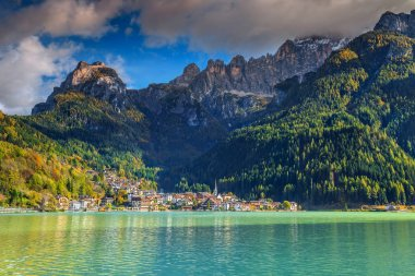 Amazing alpine village and lake in Dolomites mountains, Alleghe, Italy