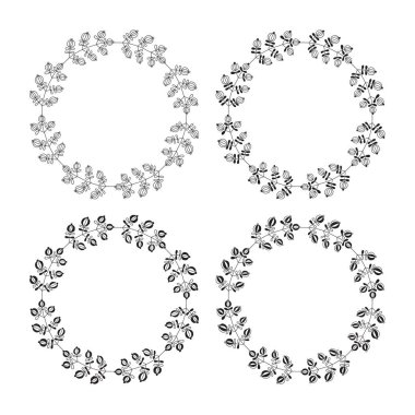 Wreaths of leaves and twigs. Set of four cute black and white vector round floral frames.