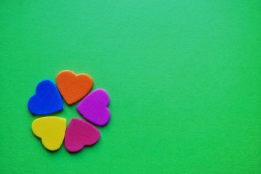 colorful hearts decoration on the green background for valentine's day