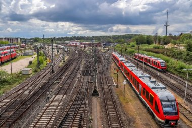 Stunning view at the railway station with trains and railroad track in a perspective view in Kiel Germany