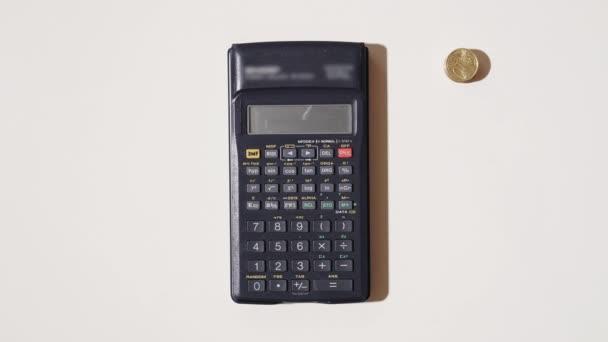 Coins appear around a calculator