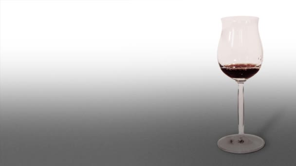 Chalice is filled with red wine on a white background