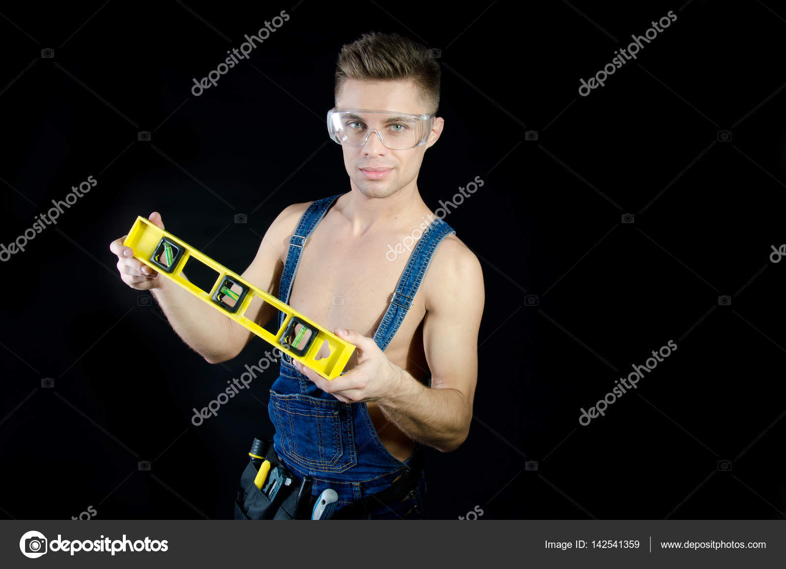 Handsome young guy. Portrait. Handyman shirtless. Smile and joy. Black  background. — Photo by vladorlov 0a0ccea296