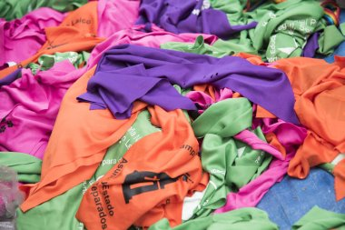 CABA, Buenos Aires / Argentina; March 9, 2020: Handkerchiefs related with different causes, legal abortion (green), not one less (purple), Church / State separation (orange), stop animal abuse (pink)