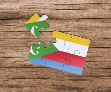 Comoros national flag on jigsaw puzzle. One piece is missing. Danger concept.