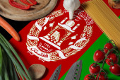 Fotografie Afghanistan flag on fresh vegetables and knife concept wooden table. Cooking concept with preparing background theme.