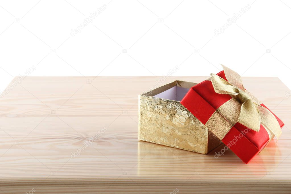 Empty gift box on wooden table