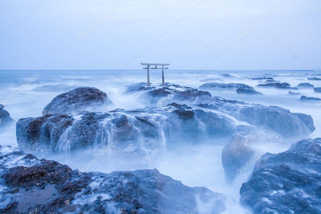 Japanese shrine gate at seashore