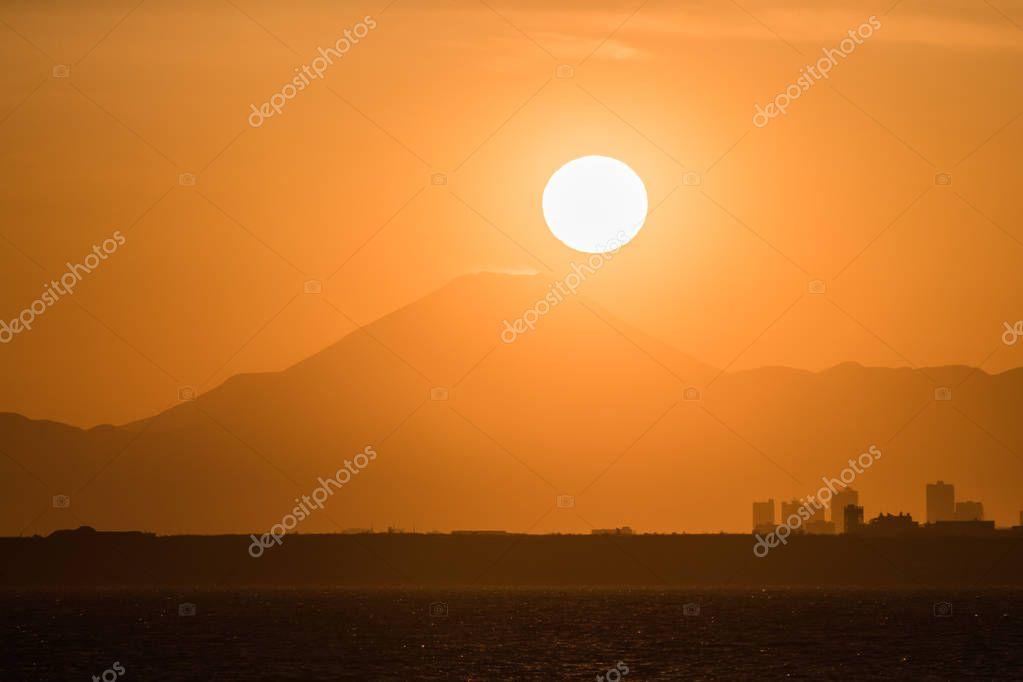 Diamond Fuji, View of the setting sun meeting the summit of Mt. Fuji
