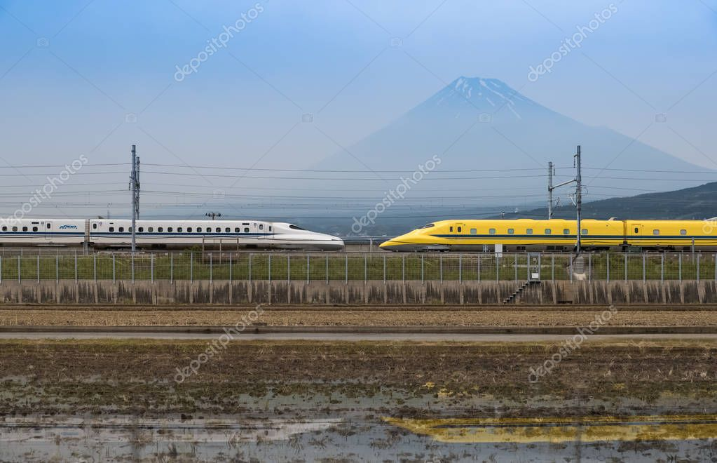 high-speed railway lines with trains on Mountain Fuji background