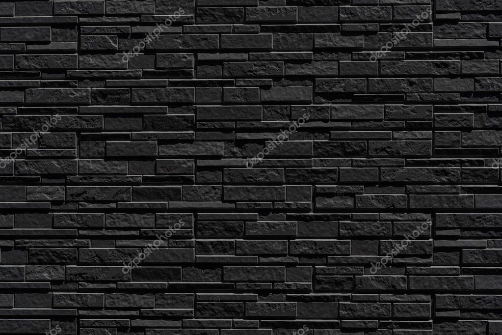 black brick wall of dark stone texture and background